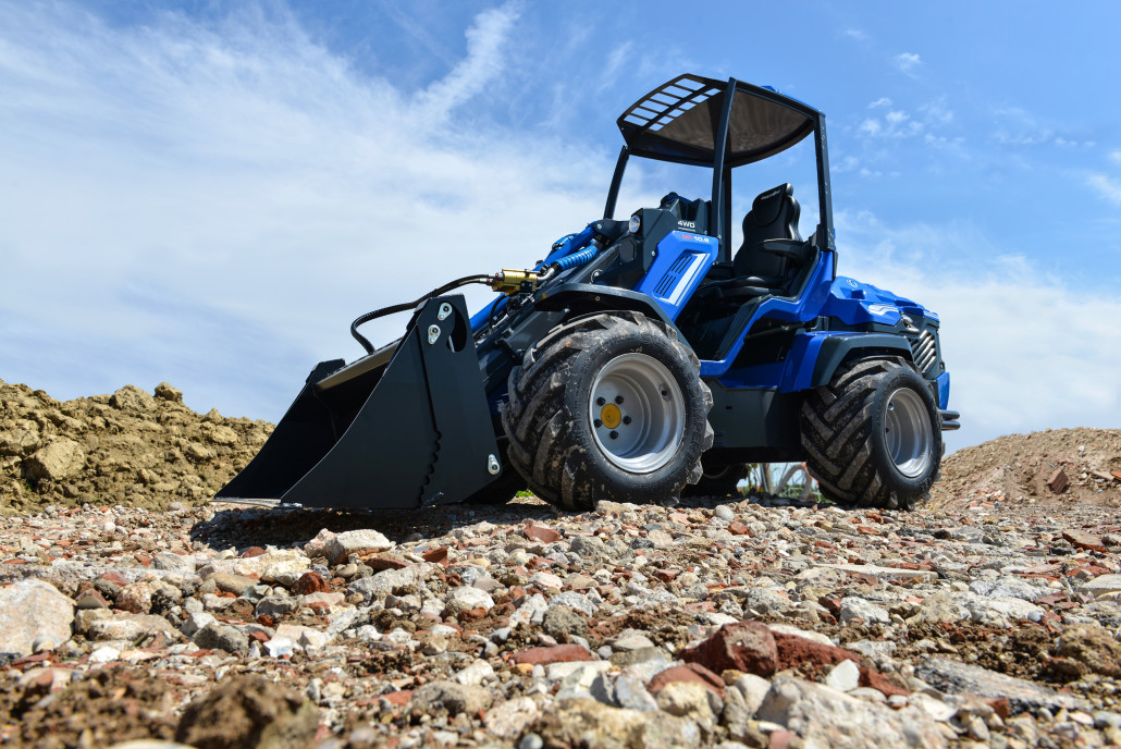 Articulated Loader vs  Skid Loader: Which One is Right for